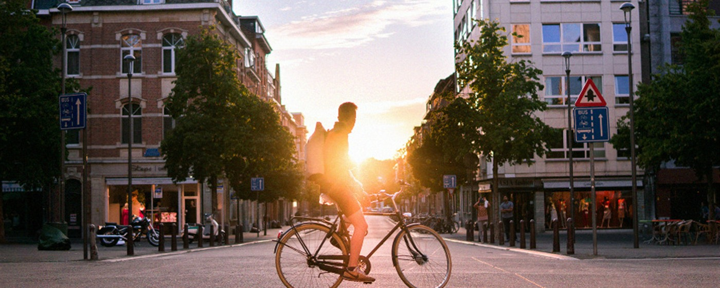 Man on a bicycle in Leuven - banner image