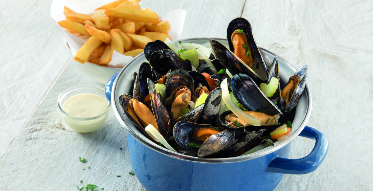 A steaming pot of fresh mussels