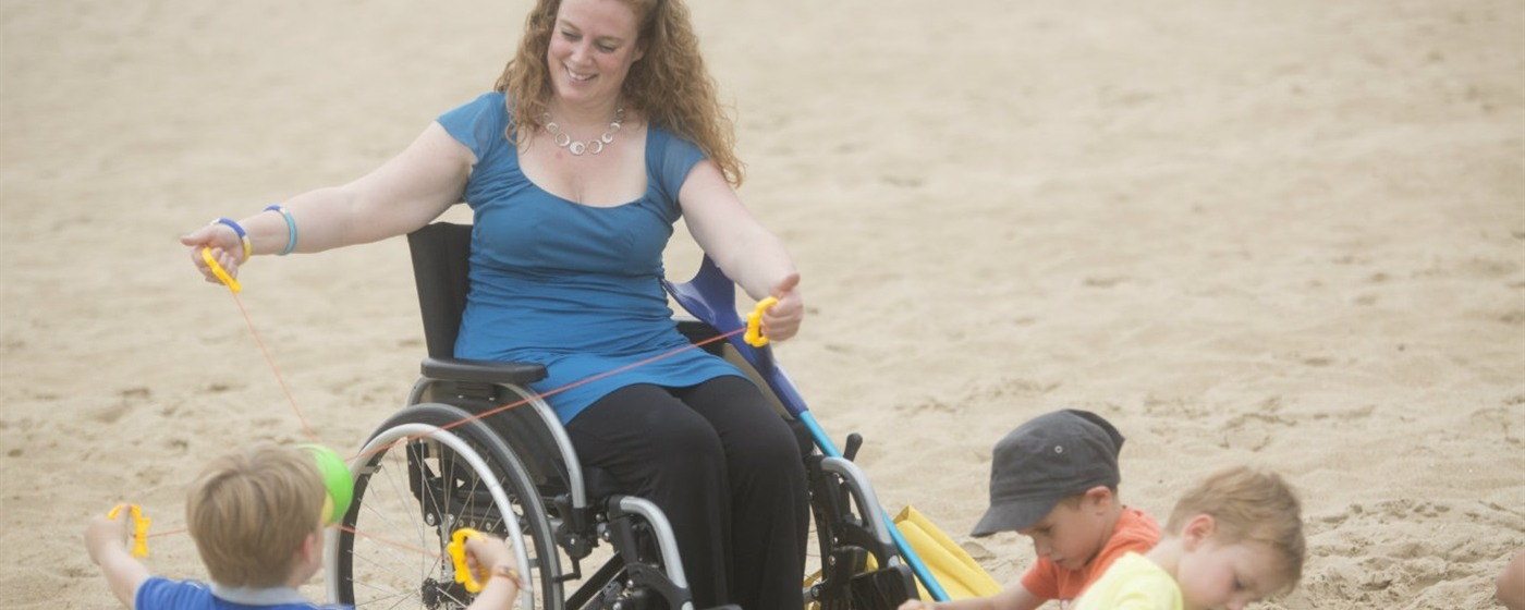 woman in wheelchair on the beach