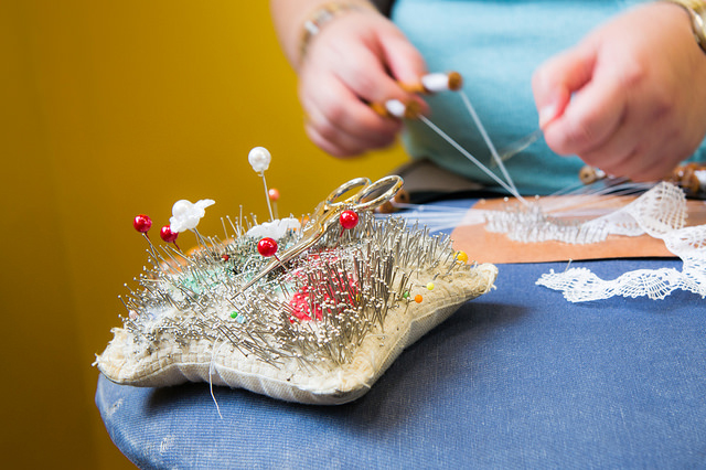 Making of lace with bobbins and needles - Kantcentrum Bruges